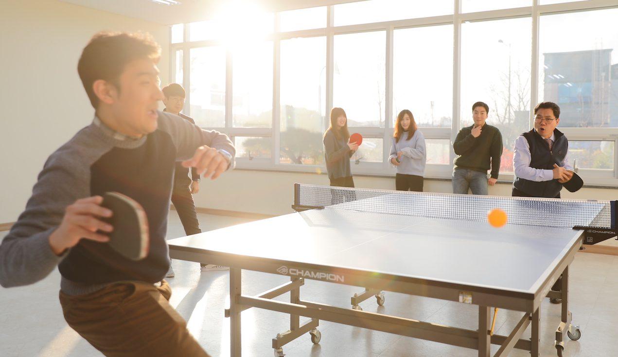 OE staff playing ping pong