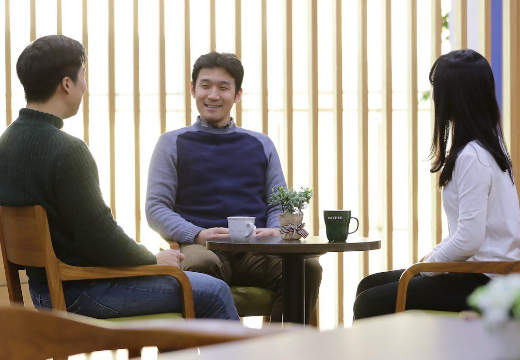 OE staff meeting with coffee